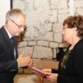 Professor Kurek is handing Professor Wilczyński's Knight's Cross of the Polonia Restituta Order over to Professor Krystyna Siwek-Wilczyńska, the widow. (photo XXIII Nuclear Physics Workshop  — Kazimierz Dolny, Michal Warda and Anna Zdeb)